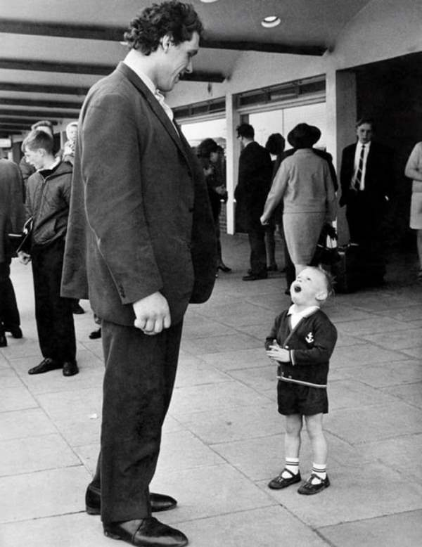 Andre the giant with little boy at airport