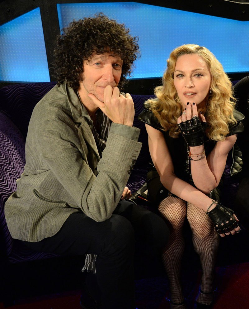Howard Stern sitting with Madonna